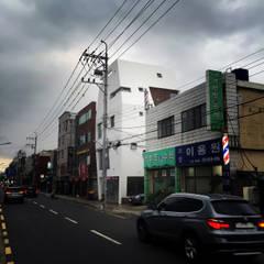 장전동 상가주택 '화양연화(花樣年華)': 민 아키텍츠 건축사사무소의  주택,