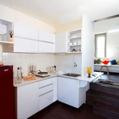 Studio Apartments:  Kitchen by Urban Shaastra
