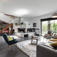 Ruang Keluarga oleh Architrek, Modern
