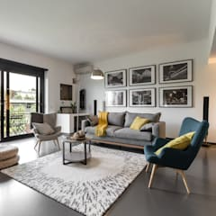 Casa MC - Relooking: Soggiorno in stile  di Architrek