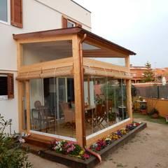 Cerramiento terraza: Casas de estilo  de Lignea Construcció Sostenible