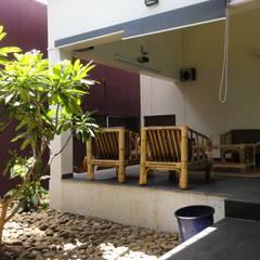 gandhi farm house: country Garden by 4th axis design studio