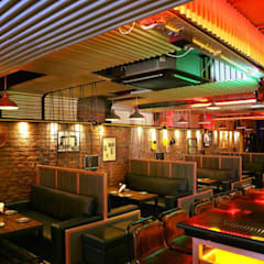 PK TUNN RESTOBAR,LUDHIANA:  Dining room by Ingenious