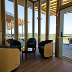 The New Club House - Espiche Golf Club: Bares e clubes  por Simple Taste Interiors