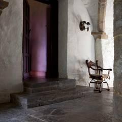 mediterranean Wine cellar by Janine Stone Design