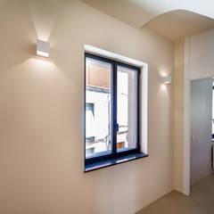 CASA FIGUERETES: Ventanas de estilo  de Lara Pujol  |  Interiorismo & Proyectos de diseño