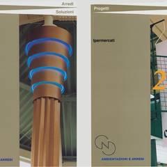 Claudio Bettini design bologna: Centri commerciali in stile  di bettini design