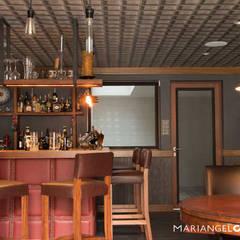 modern Wine cellar by MARIANGEL COGHLAN