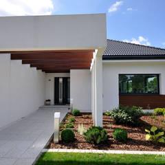 Realizacja projektu HomeKONCEPT 26: styl , w kategorii Domy zaprojektowany przez HomeKONCEPT | Projekty Domów Nowoczesnych