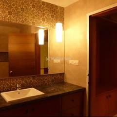 Interiors for a Villa at Ferns Paradise, Bangalore:  Bathroom by Mallika Seth