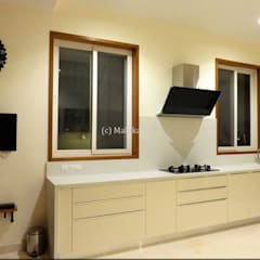 Interiors for a Villa at Ferns Paradise, Bangalore:  Kitchen by Mallika Seth