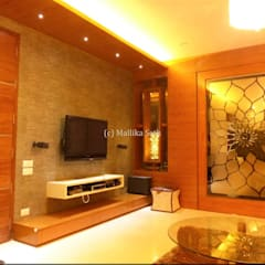 Interiors for a Villa at Ferns Paradise, Bangalore:  Media room by Mallika Seth