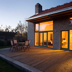 The Iron Porch House:  Terrace by Földes Architects