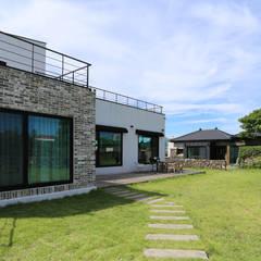 까사봉봉: 아키제주 건축사사무소의  정원,