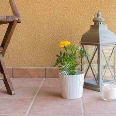 REPORTAJE FOTOGRÁFICO ALQUILER EN SOJUELA: Terrazas de estilo  de Become a Home