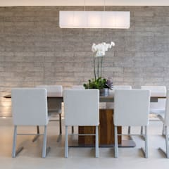 Grey Exposed Brick Dining Room: minimalistic Dining room by Gracious Luxury Interiors