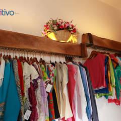Tienda Oro y Plata de Oaxaca: Paredes de estilo  por Additivo al diseño , Ecléctico