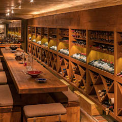 Wine cellar by MARVIN FARR ARCHITECTS