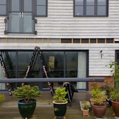 Removing the cladding:  Terrace by Premier Blinds, Shutters & Awnings