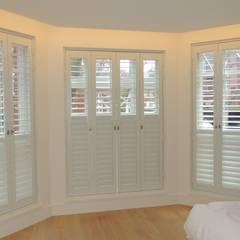 Rhino Shutters - security plantation shutters in London:  Bedroom by Premier Blinds, Shutters & Awnings