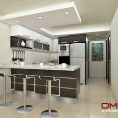 Diseño interior en apartamento : Cocinas de estilo  por om-a arquitectura y diseño,