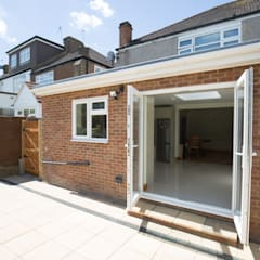 Big doors out into the garden:  Houses by The Market Design & Build