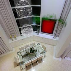 Casa Moinho dos Ventos: Salas de jantar  por Arquiteto Aquiles Nícolas Kílaris