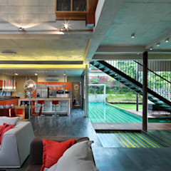 Living Room with connected pool:  Living room by MJKanny Architect