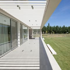 CASA ML: Jardines de invierno de estilo  por DMS Arquitectura