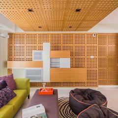 APARTAMENTO 10A GRAND EUROPA: una vivienda a 3 ritmos: Salas de entretenimiento de estilo  por NMD NOMADAS
