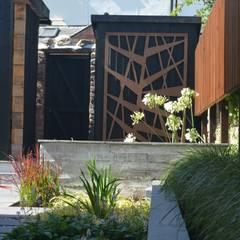 Concrete wall:  Garden by Robert Hughes Garden Design