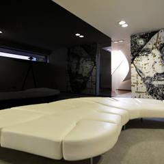 Sala de Espera - Casa das Artes by Musa Décor: Adegas  por Musa Décor