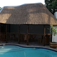 Thatch Lapa & Entertainment Areas:  Pool by Cintsa Thatching & Roofing, Rustic
