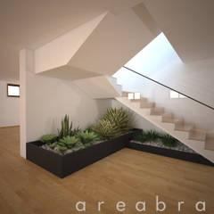 Salão Polivalente: Salas de estar modernas por Areabranca