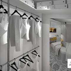 Przytulny Skandynawski loft: styl , w kategorii Garderoba zaprojektowany przez PUHALSKA DESIGN