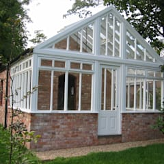 Private gothic mansion fully restored with new garden room to terrace, brick built courtyard and grand entrance gates:  Garage/shed by Des Ewing Residential Architects