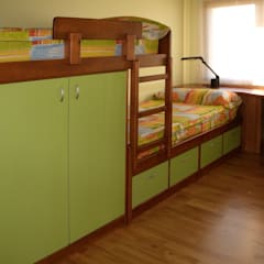 Nursery/kid's room by RIBA MASSANELL S.L., Mediterranean Wood Wood effect