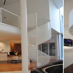Concession Jaguar - Land Rover JONNAERT S.A. CUESMES: Concessions automobiles de style  par VORTEX atelier d'architecture