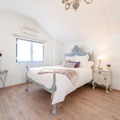 Um apartamento com um toque descontraído de campo em plena cidade. Quartos campestres por alma portuguesa Campestre