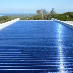 Die Poolabdeckung in Solarausführung: mediterraner Pool von Hesselbach GmbH