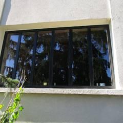 verriere interieur ,exterieur: Fenêtres de style  par metallerie swiatek