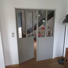 porte double façon verriere: Fenêtres de style  par metallerie swiatek