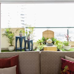 Wide view of the Balcony from inside the living room.: eclectic Living room by Studio Earthbox