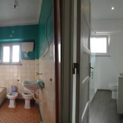 Remodelação Apartamento, Águas Livres, Amadora: Casas de banho  por Happy Ideas At Home - Arquitetura e Remodelação de Interiores
