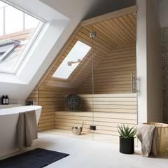 Sotto il cielo di Berlino design e comfort in un loft di 320 mq: Spa in stile in stile Moderno di Design for Love