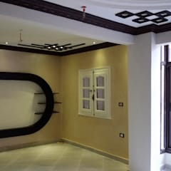 Mr. Mohamed Appartment:  غرفة المعيشة تنفيذ Etihad Constructio & Decor,