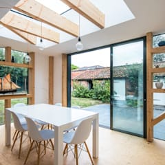 Staggered Glulam Extension, 2016:  Dining room by Thomas & Spiers Architects