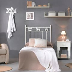 Nursery/kid's room by Muebles Soliño,