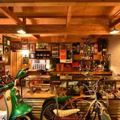 HA邸: Sen's Photographyたてもの写真工房すえひろが手掛けたガレージです。