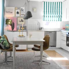 Wohnung im tropischen Stil:  Esszimmer von Homemate GmbH,